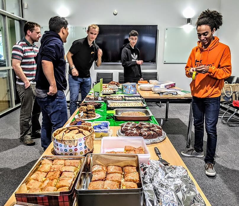 Team and cakes